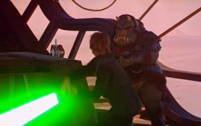 Luke Skywalker cuts down the mighty Gamorrean.