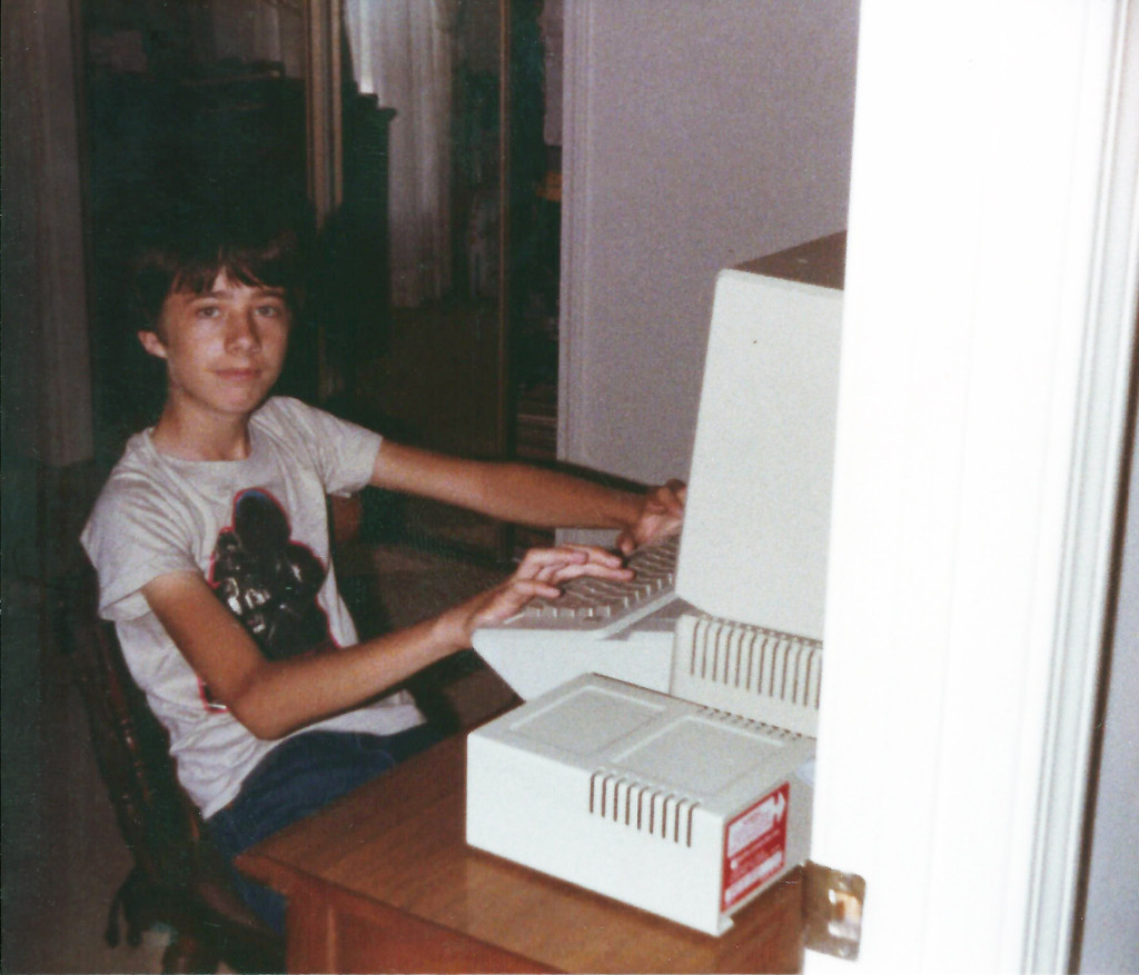 Wearing a Return of the Jedi shirt at 15 with my first computer. The machine still works, but the shirt no longer fits.