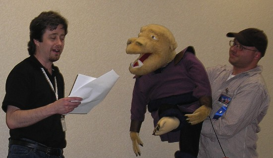 Doing a reading with the Gryph puppet at Midsouthcon in 2010.