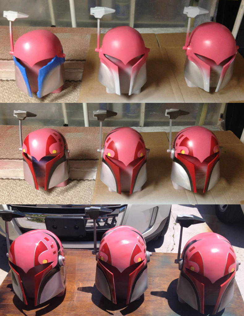 Sabine helmets in various stages of painting. You can see the crisp edges and sharp corners, signature of a great airbrush artist.