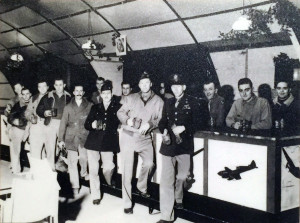 Service members gather at The Belly Tank bar in Debden, England during World War II.