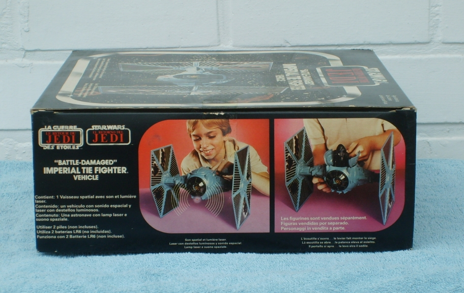 Tie fighter toy with battle damage  - side of box