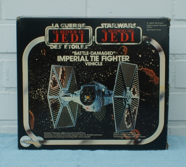 Tie fighter toy with battle damage  - bi-logo box cover