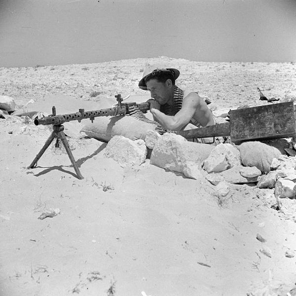 A Commonwealth soldier manning a captured MG34 Machine Gun